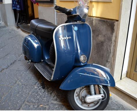 A blue Vespa