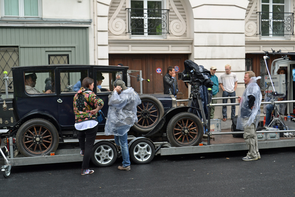 old car on a flatbed truck for a movie scene