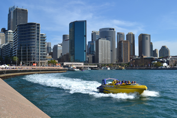 View of Sydney with speed boat.